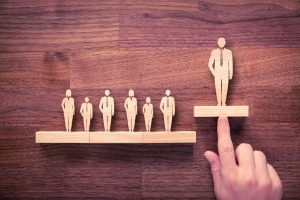 wooden figures showing leadership