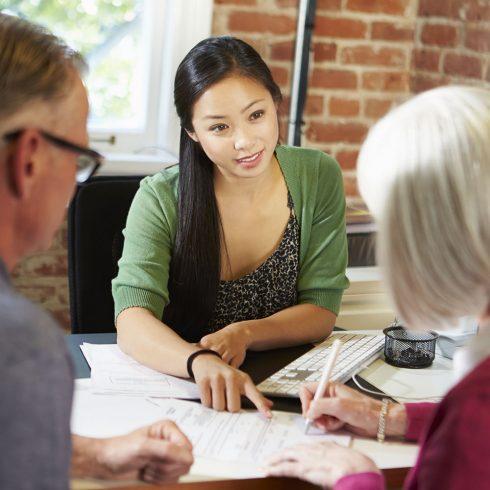 Senior Couple Meeting With Financial Advisor