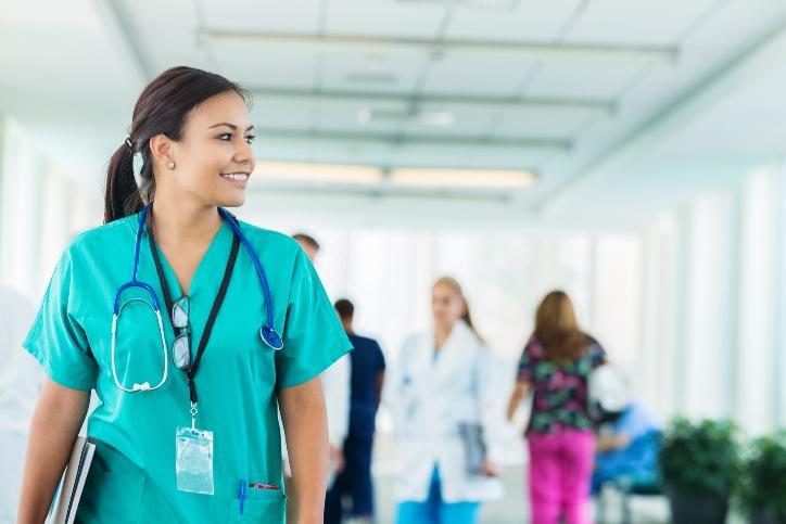 Doctor of Nursing walking through a hospital