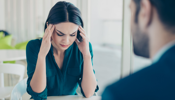 stressed woman talking to her boss