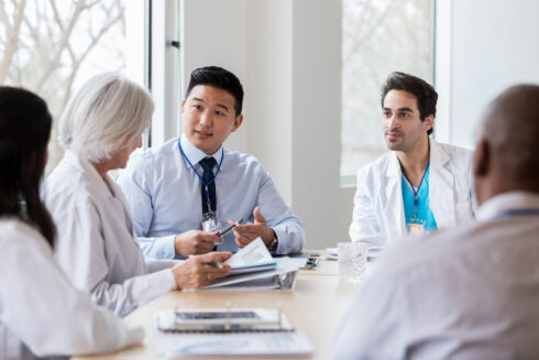 Healthcare Professionals Having Conversation in Hospital Conference Room