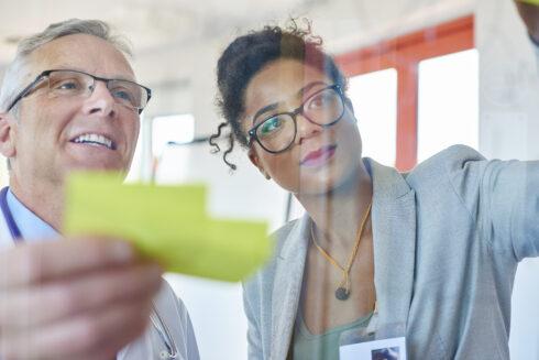 senior doctor and businesswoman brainstorming