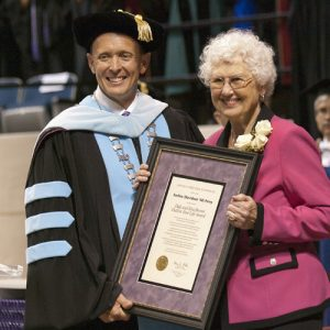 ACU president Dr. Phil Schubert presents Earline Perry with the 2013 Dale and Rita Brown Outlive Your Life Award.