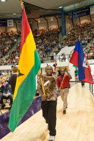 Students, staff and faculty carry flags representing the U.S. states, territories and nations represented on campus.