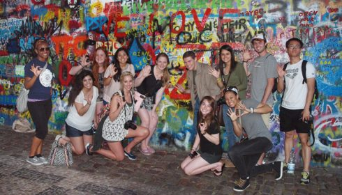 "ACU students from the journalism and mass communication, and art and design departments pose at the John Lennon Wall in Prague: (top, from left) senior Jessica Brown, junior Jamie Swallows, junior Audrey Gonzalez, sophomore Amy Sloan, sophomore James Eldred, sophomore Brittany Coons, sophomore Logan Sartain, senior Zejun ""Jack"" Jiang (bottom) junior Margo Herrera, sophomore Chera Chaney, junior Natalie Goin and senior Arielle Moncure."