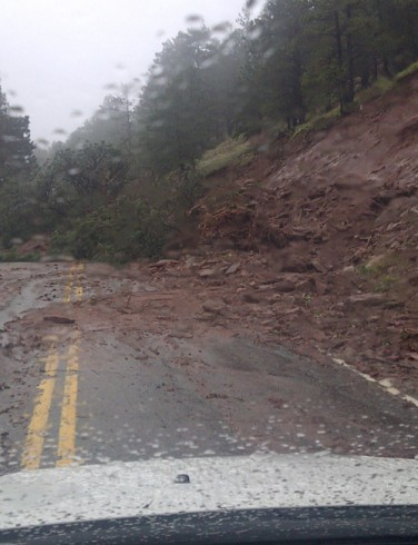 Mudslides like this – including trees and boulders – were common on the road Watson had to navigate outside Boulder.