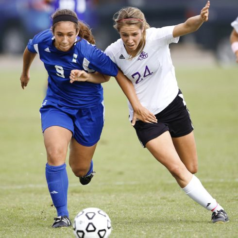 Freshman defender Alyssa Gerner battles Meghan Cordero from the Texas A&M-Corpus Christi.