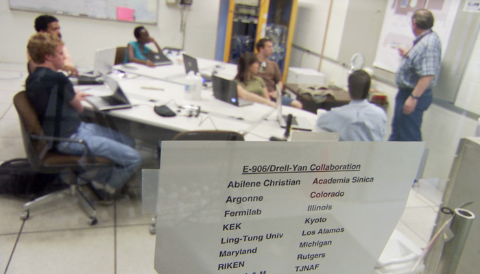 ACU is on a short list of universities in the world whose undergraduate physics students are collaborators on nuclear experiments at Fermilab near Chicago. Here, Dr. Donald Isenhower ('__) meets with his students in 2009 in a conference room at Fermi
