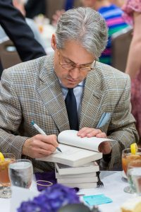 Metaxas signing books at luncheon