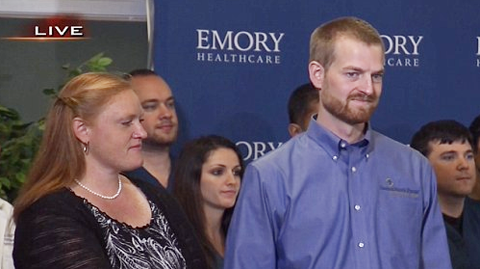 Kent Brantley, M.D. ('03) was joined at today's press conference by his wife, Amber (Carroll '06).