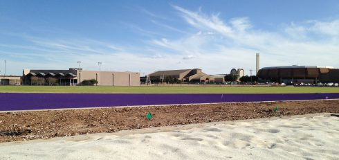 Grass on the soccer pitch, the new purple track, dirt at the construction site and sand in the long-jump pits provide a contrast in colors at the new track/soccer stadium.