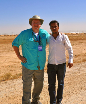 Danny Sims ('85) is shown at the Syrian border at the U.N.'s Zatari refugee camp with his driver, Ali Hussein, assessing what U.S. Christians can do for the refugees of the Syrian war.