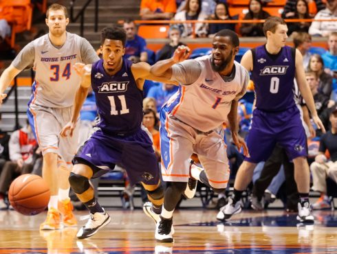 ACU's Harrison Hawkins (11) and Boise State's Mikey Thompson (1) battle for a loose ball in the Broncos' big win over the Wildcats.