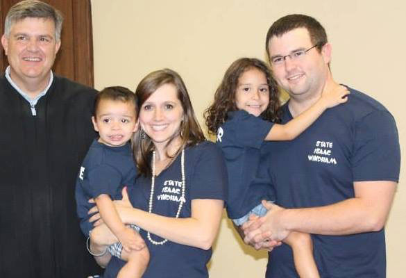 Brenna and John Windham with their children, State and Grace, on State's adoption day.
