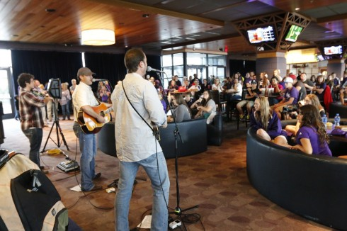 When rain washed out a pre-football game gig in September 2013 in Frisco, Texas, Watson and his band moved indoors for an impromptu concert for Wildcat fans.