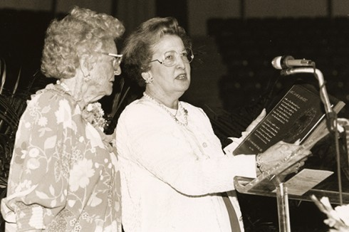 Peggy reads a dedicatory plaque for the Mrs. Don H. Morris Living Area at ACU. Morri s (left) was the wife of the university's seventh president, Dr. Don H. Morris.