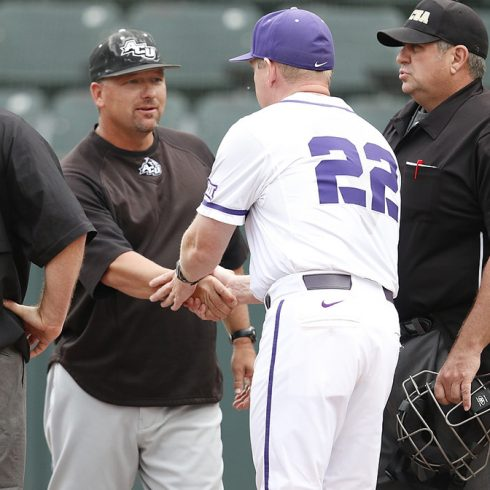ACU head coach Britt Bonneau greets TCU head coach _______ before a recent game.