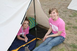 Madison Shaw (left) and Savannah Richardson are ready for the overnight frontier life challenge.
