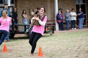 Mariana Cedillo takes on the firewood relay.