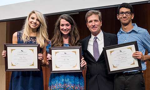 Lytle posed with three of COBA's top graduating seniors in May 2015: (from left) Neely Borger, Allison Phillips and Ariel Santos.