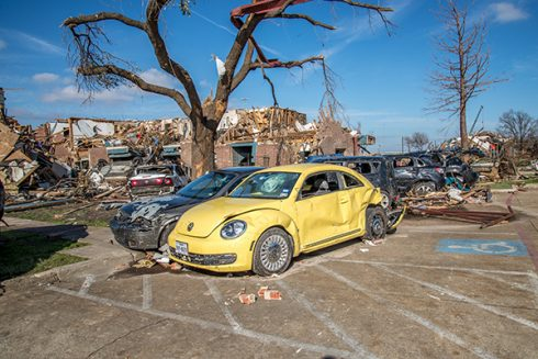 A yellow Volkswagen, one of the Harbours' vehicles, was heavily damaged in the storm.