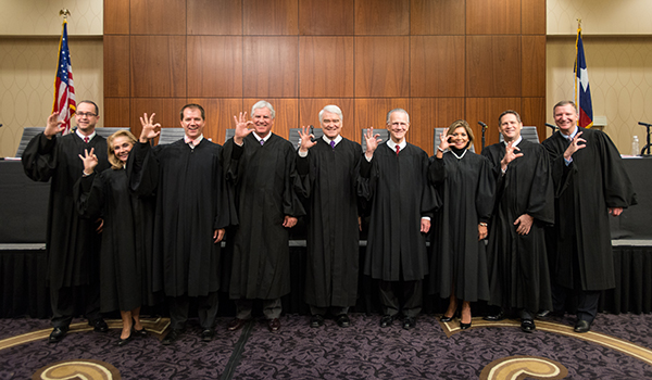 Justices _____ flash the W-C to the delight of the ACU audience gathered in the McCaleb Conference Center.