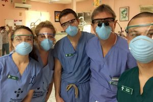 (From left) Laura Edwards, Elena Taylor, Colton McCoy, Michael McCoy and Jeremy Aymard work in HTI's on-site dental clinic.