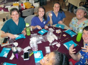 Student volunteers sort medication into packets to be distributed by physicians. Clockwise from left are Jill Baker, Evan Bridges, Laura Edwards, Houston Schoonmaker, Tanner Gregory and Taylor Fernandes.