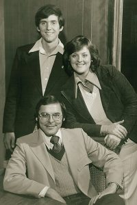 1975 Sing Song co-chairs David Little ('__) and Liz Campbell ('__), and director Herb Butrum ('__).