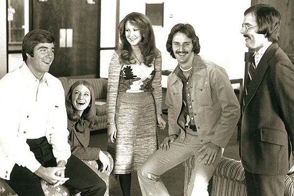 1976 Sing Song hosts and hostesses (from left) John Vaughn ('76), Cindy (Blanton '76) Zahodnik, Janna (Hopson '77) Rosier and Darren Lackey ('76), and director Herb Butrum.