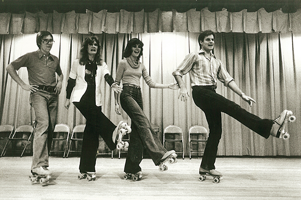 1978 Sing Song hosts and hostesses rehearse on roller skates (from left): Jeff Nelson ('79), Colleen (Smith '76) Crawford, Holly Dunn ('79) and Don Piper ('78).
