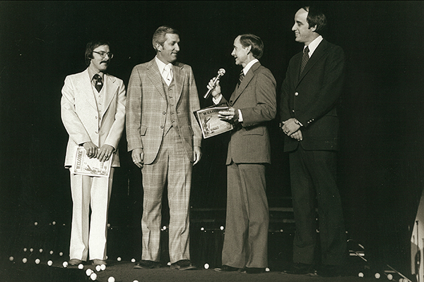 "Sing Song 1976 coincided with Abilene's Bicentennial. Here, Butrum, Abilene Bicentennial Committee representative Bob McCathren, Dr. Robert D. ""Bob"" Hunter ('52) and McCaleb share the stage."