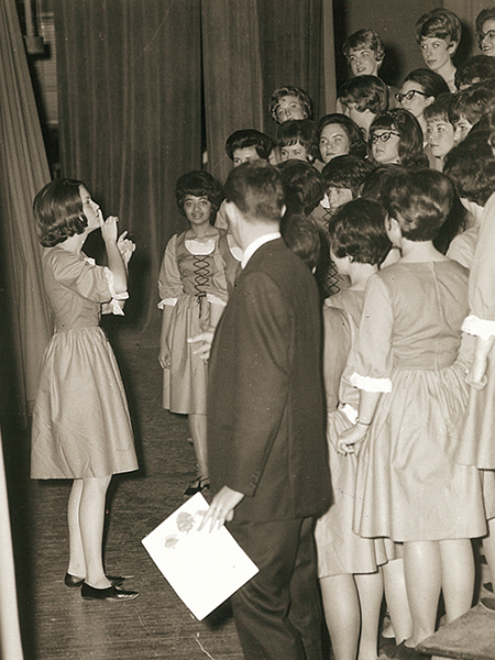 Women's club Zeta Rho prepares backstage to perform in Sing Song 1966.