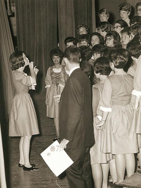 Women's club Zeta Rho prepares backstage to perform in Sing Song 1966.