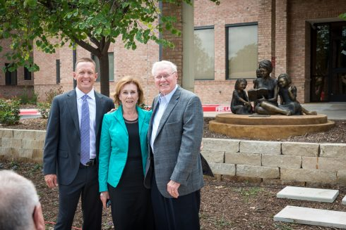 Dr. Phil Schubert with Gayle and Max Dillard in front of Dillard Hall at ACU.