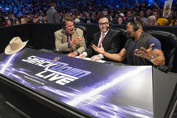 "Layfield (left) with announcer Mauro Ranallo and wrestler David Otunga during a ""Smackdown Live"" broadcast. (Photo courtesy of WWE Inc.)"