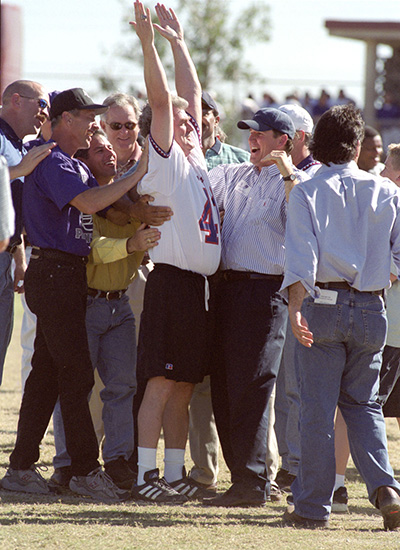 Johansson's teammates celebrate with him after a 53-yard field goal he kicked during a 2001 halftime exhibition.
