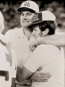 Dewitt Jones hugs defensive coordinator Jerry Wilson after the 1977 Apple Bowl win in the Kingdome.