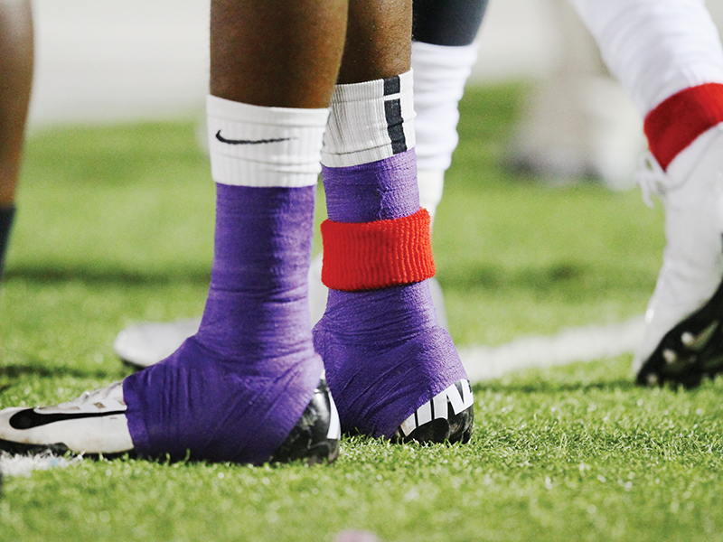 Each ACU player wore a red sweatband around an ankle during the 2012 game with Incarnate Word.