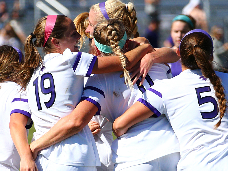 Chloe Fifer (19), Dylan Owens (11) and Caity Acosta (5) celebrate during a 2-0 late-season win over Stephen F. Austin on Oct. 22.   PHOTO BY TIM NELSON