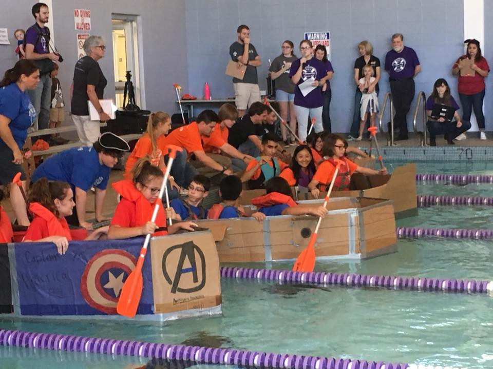 Middle school students race boats they constructed from cardboard, duct tape and glue with the guidance of ACU engineering and physics students.