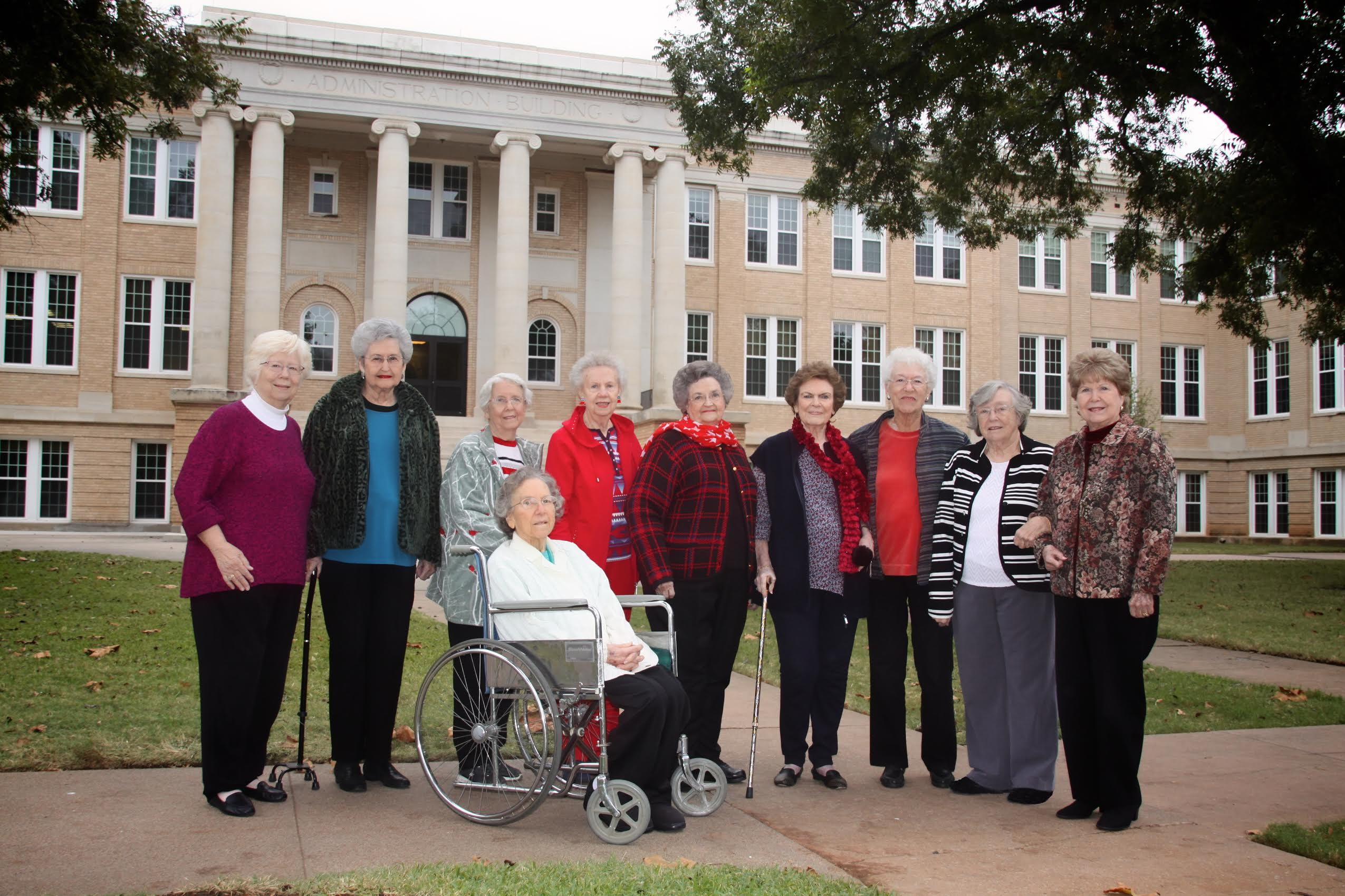 "Members of the Class of 1955's ""Lunch Bunch,"" from the left: Wanda (Porter) Craig; Betty (Griffin) Hale; Linda (May) Hart; Joyce (Kent) Faver; Peggy (Gambill) Marler; Jo (Turner) Etter; Chris (Terry) Grounds; Bernice (Bourland) Scott; Betty (Phillips) Grant. In front: Nancy (Lewis) Ferguson."