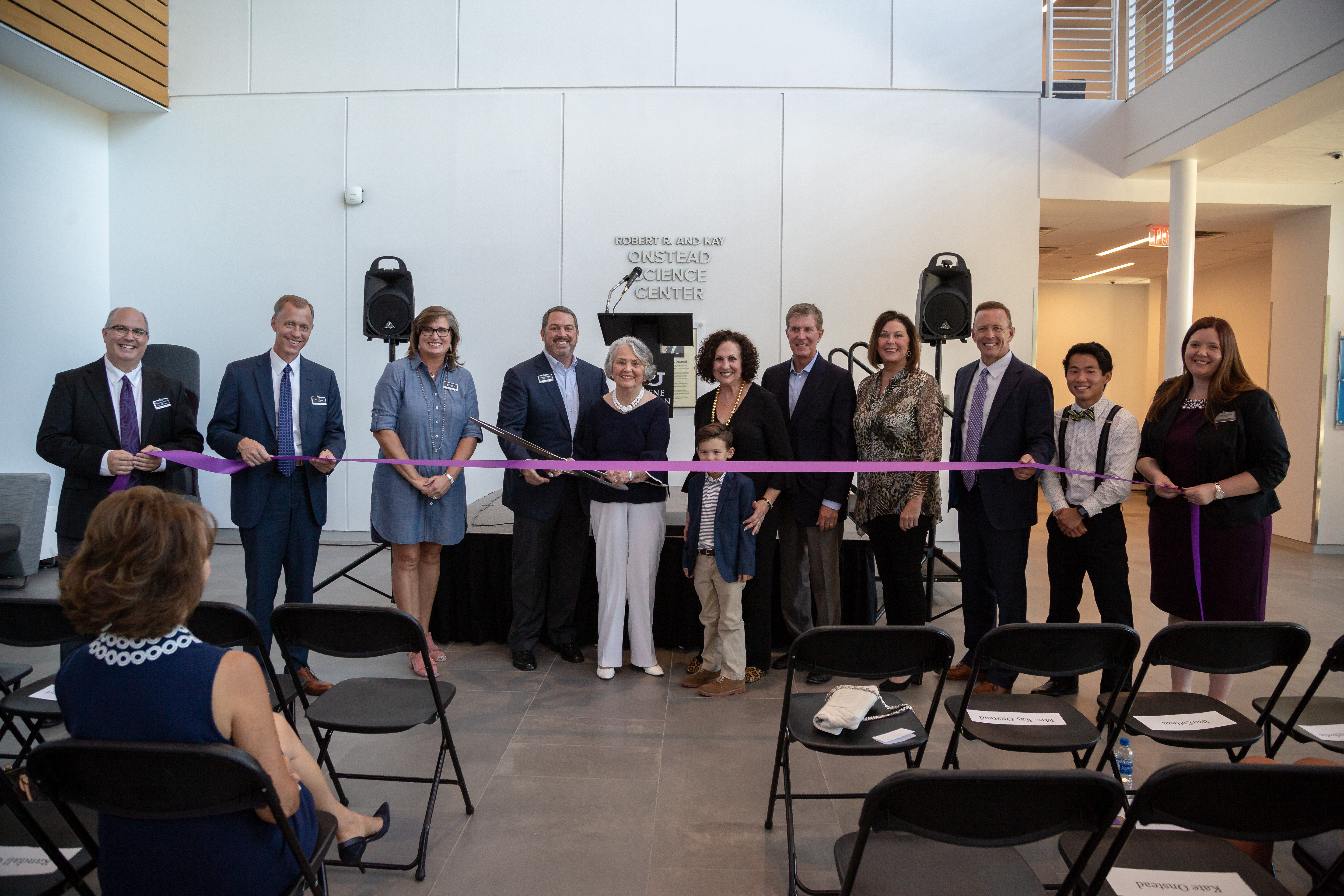 The opening of the Robert R. and Kay Onstead Science Center featured the cutting of a ceremonial ribbon. Pictured from left: Dr. Gregory Straughn, dean of the College of Arts and Sciences; Dr. Robert Rhodes, provost; April Anthony, chair of the Board of Trustees; Charlie Onstead; Kay Onstead; Ann Hill; Randall Onstead; Mary Onstead; Dr. Phil Schubert, president; Bao Catteau, sophomore; and Dr. Autumn Sutherlin, assistant dean of the College of Arts and Sciences.