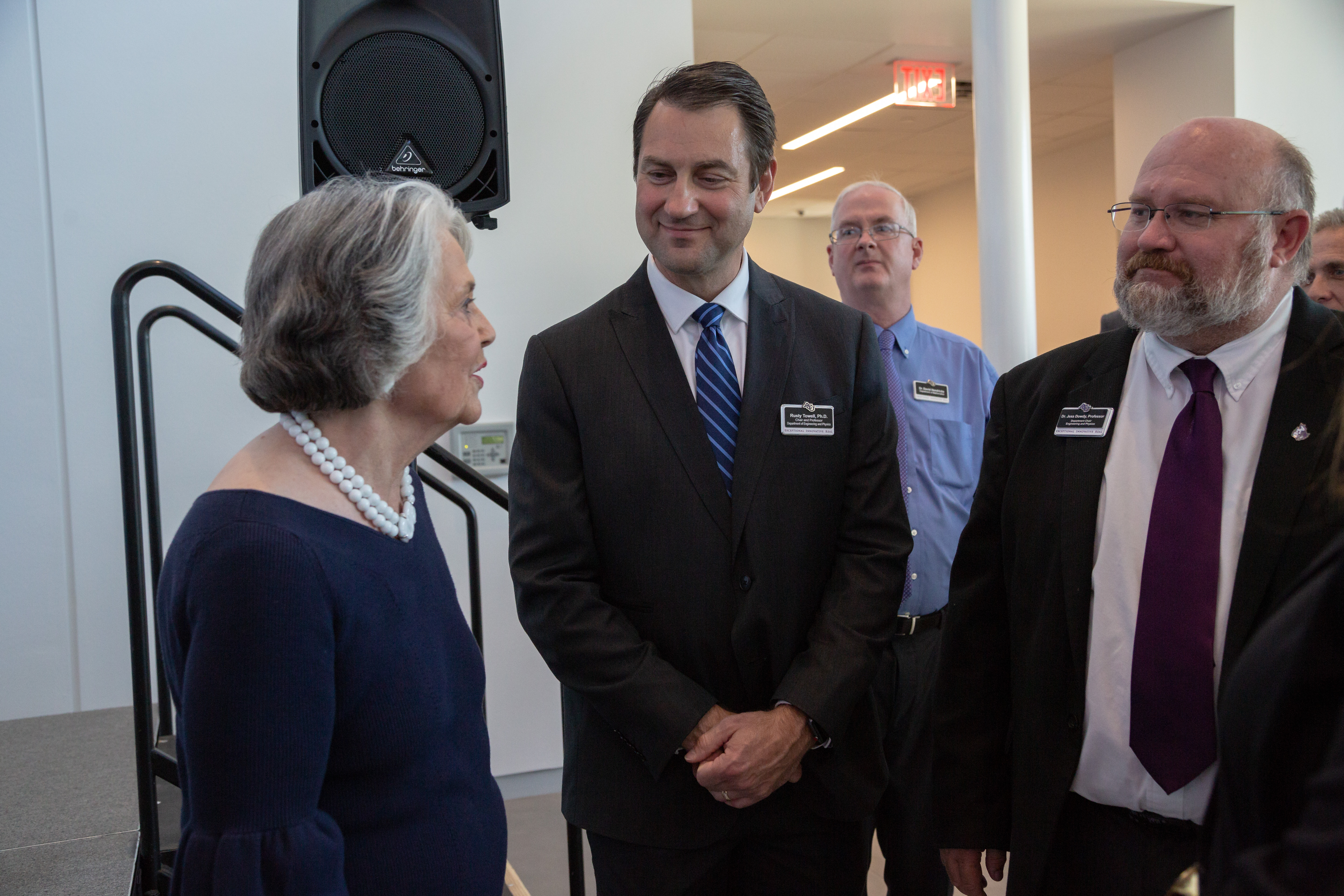 Kay Onstead speaks with Department of Engineering and Physics faculty Dr. Rusty Towell (center) and Dr. Jess Dowdy.