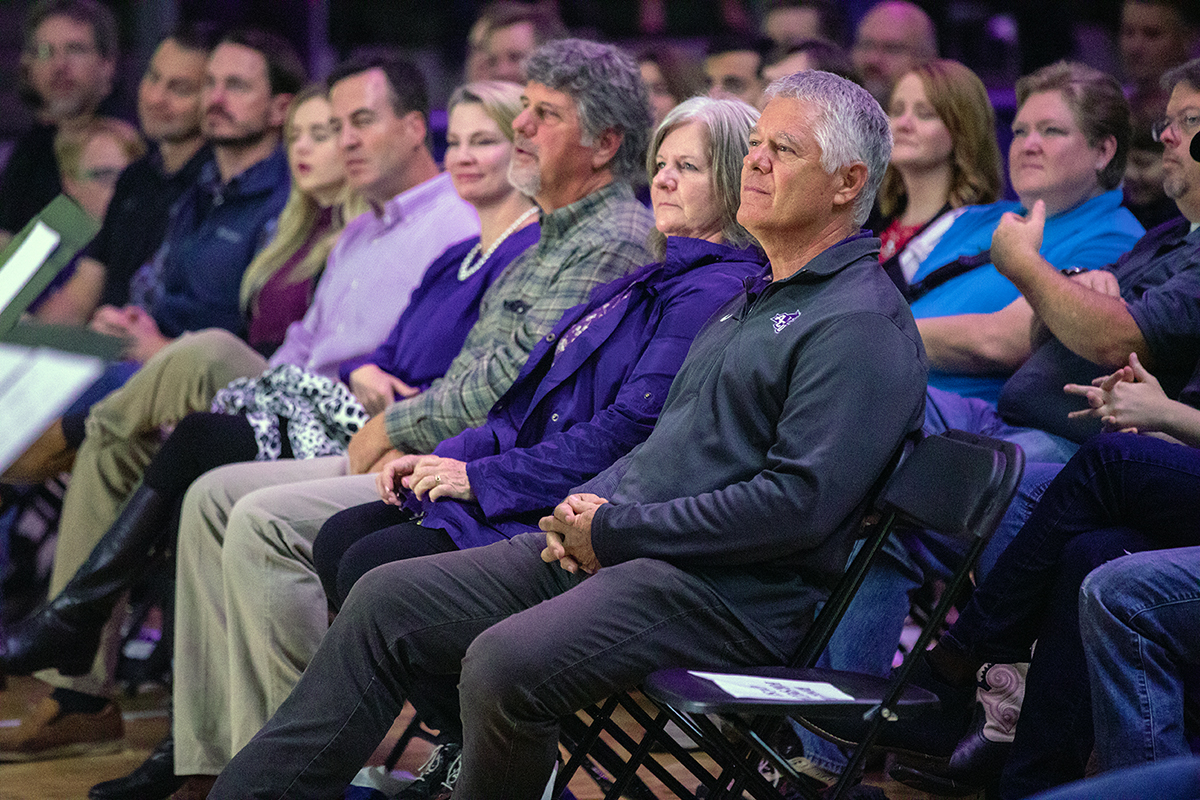 Doug and Angie Robison listen during Homecoming Chapel on Saturday, Oct. 13, 2018. Next to them are Doug's brother, Dan, and his wife, Pam. The Robison family are members of the Robison Excelsior Foundation, which has pledged $3.2 million to ACU's NEXT Lab.
