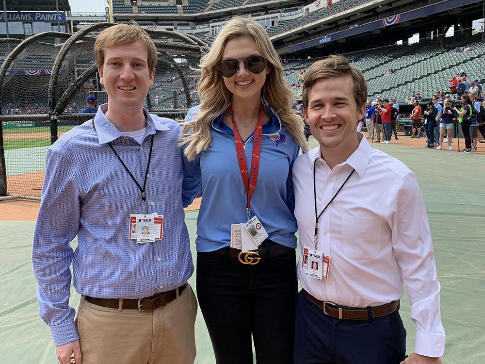 ACU graduate Ryan Cantrell (left) with colleagues Hannah Wing and Kyle Smith at Globe Life Park in Arlington, home of the Texas Rangers.