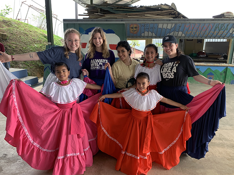 ACU students (from left) Madeline Dayton, Katey Loveless, Mafer Hernandez and Alison Zuniga are shown local dances by children in the village of Mollejones. The students were part of a Study Abroad course offered by the College of Business Administration.