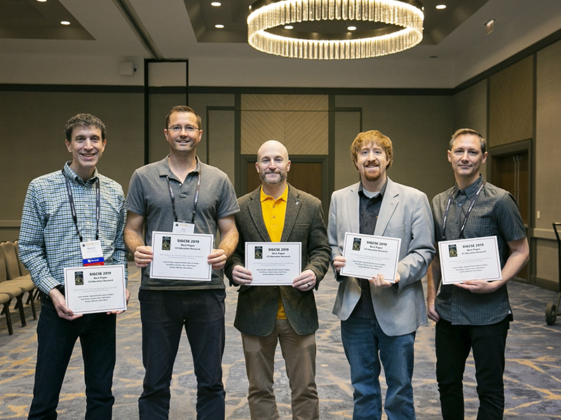 Prather, second from right, poses with co-authors of a research paper on metacognitive scaffolding which won the Best Paper Award at the Special Interest Group in Computer Science Education (SIGCSE) conference.