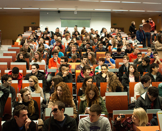 College students gathered in a tiered lecture hall.