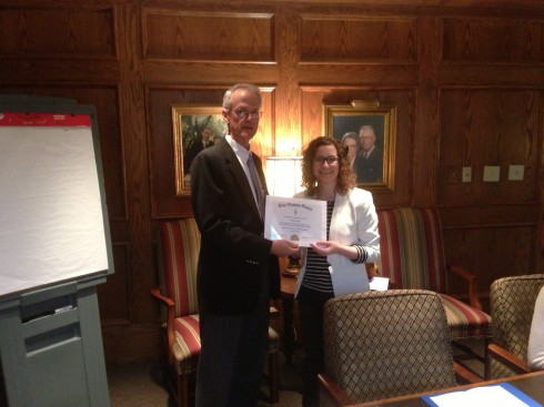 Ashley Crisp receives her certificate of membership